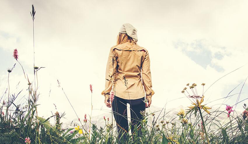 girl walking on flower fields establishing yourself as sole practitioner