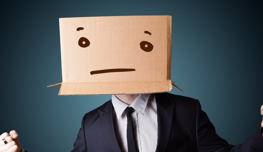 lawyer sad face brown carton box  on head professional lawyers depression