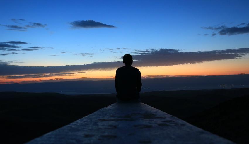 Sunrise, man looking at the sunrise