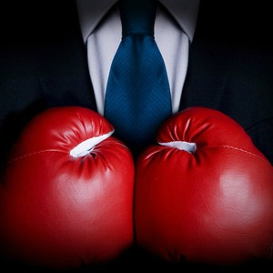 lawyer with boxing gloves biglaw v newlaw debate better offering to legal professionals